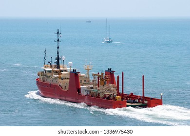 The red color ship - tanker left Key West town (Florida).