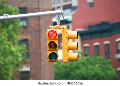 Red color traffic light with buildings in the background. Traffic light wallpaper.