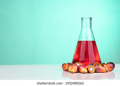 Red color unrefined palm oil and fruits with beaker in laboratory. Rich in carotenoids and is good for health