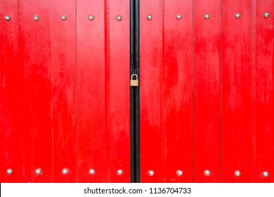 Red color wooden door was locked with gold key.Doors with Chinese style