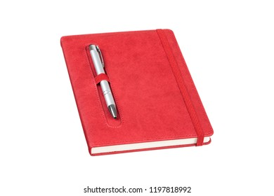 The red colored leather daily planner has pen holder and elastic banded, it is on the grey pen isolated on white background. The allows you to save your notes and organized on a daily basis.