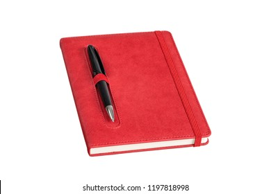 The red colored leather daily planner has pen holder and elastic banded, it is on the black pen isolated on white background. The allows you to save your notes and organized on a daily basis.