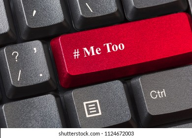 Red colored Me Too button on black computer keyboard. Sexual harassment concept.