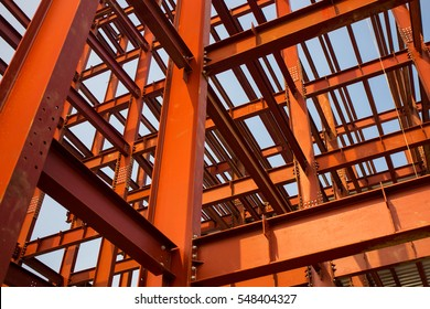 Red colored steel beam skeleton construction