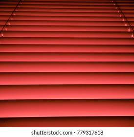 Red colored window blinds and shades. Texture and Background