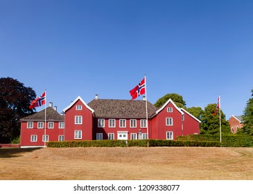 Red colored wooden Herregarden Manor House, one of Norway's finest secular Baroque structures in Larvik, Vestfold County, Norway