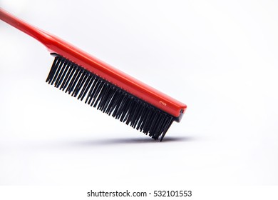 Red comb on white background. Isolated