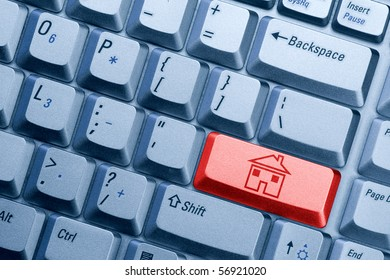 red computer  keyboard button with house icon