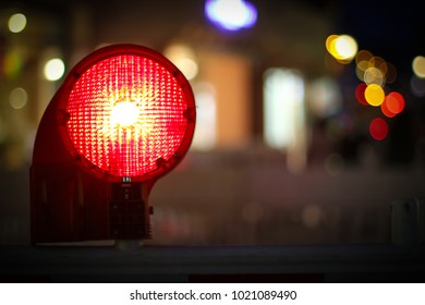 Red construction light by night
