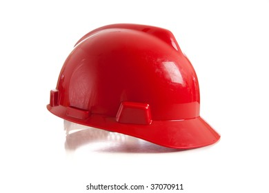 A red construction workers helmet on a white background