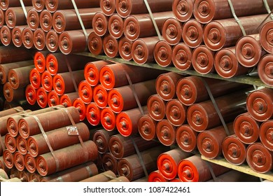 Red conveyor rollers, drive drums, tension stations