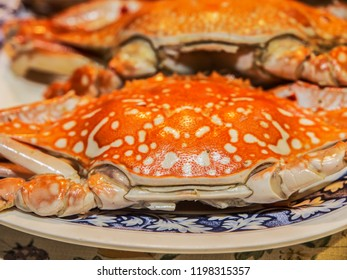 A red, cooked crab on a plate as part of a seafood platter in a gourmet restaurant in Thailand