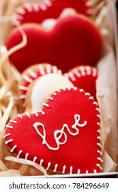 Red cookies hearts with white icing Love in white box .Gift for Valentine's Day.Valentine day background.Closeup
