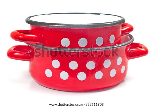 Red cooking pot with dots isolated on white
