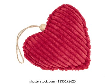 Red cord fabric heart shape pincushion isolated on white.