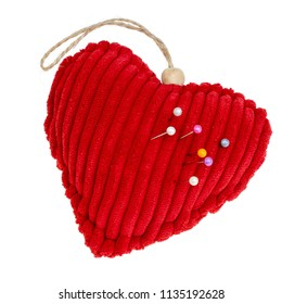 Red cord fabric heart shape pincushion isolated on white. With pins.