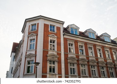 red corner building with white stucco details
