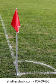 Red corner flag on a soccer field