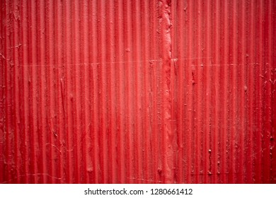 Red corrugated metal zinc wall for background or texture