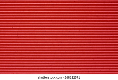 red corrugated paper background.