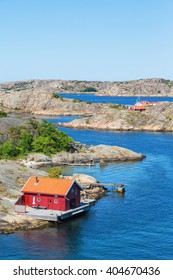 Red cottage by the sea on the Swedish west coast