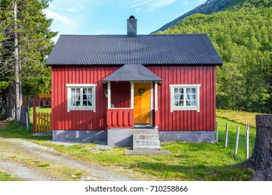 Red cottage. Hill in background. Beautiful landscape. Norway