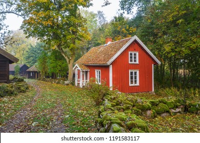 Red cottage in a village in the countryside