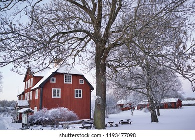 Red cottage in wintertime