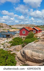 Red cottages by the bay on the Swedish west coast