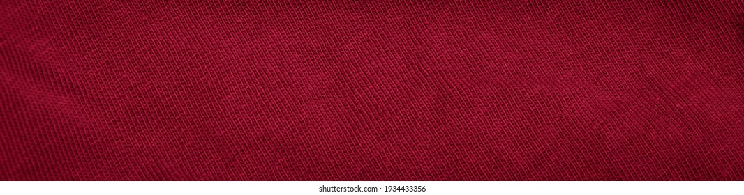 red cotton fabric with visible details. background or textura - Shutterstock ID 1934433356