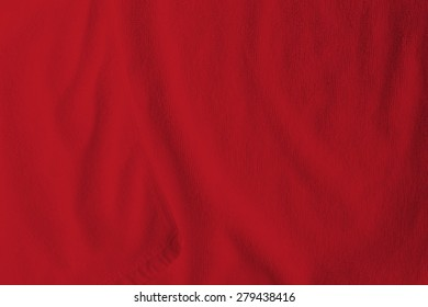 Red cotton towel close up background photo texture