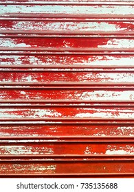 Red cracked paint on wood blinds
