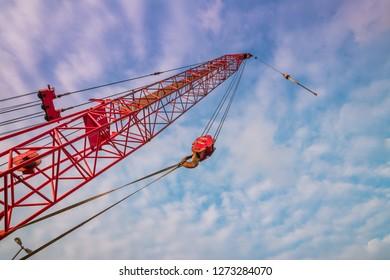 Red crane on sky background
