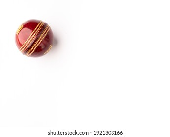 Red cricket ball isolated stock image.