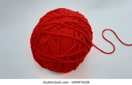 red crochet woolen yarn ball isolated on white background