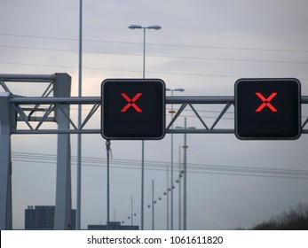 Red cross avove lanes on the dutch motorway, no trespassing allowed when this cross is on the lane.