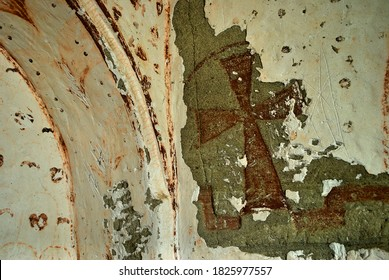 Red Cross murals in ancient Christian cave church with red ornaments. Cappadocia Turkey. UNESCO World Heritage Site.