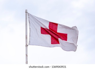 Red Cross on White Flag as first Aid Sign