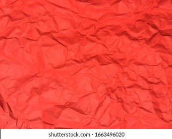 Red crumpled paper texture background for Design. Wallpaper  for copy space