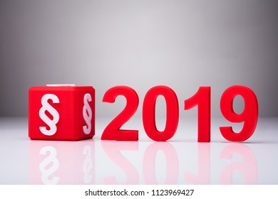 Red Cube With Paragraph Symbol Besides Year 2019 On Reflective Background