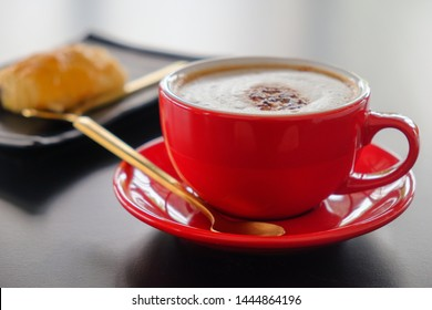 Red cup cappuccino coffee​ and bakery background