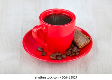 red cup coffee with coffee beans  on wooden table