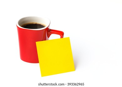 Red cup coffee with blank yellow note paper on white background, soft focus