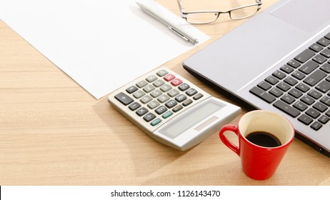 Red cup coffee and calculator and white blank page for business concept