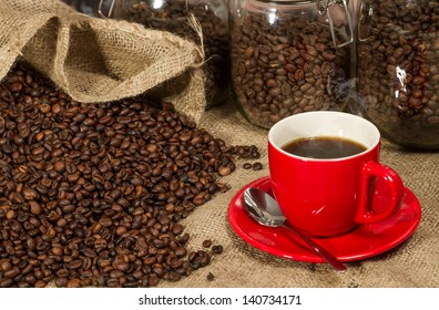 Red cup of coffee and glass containers