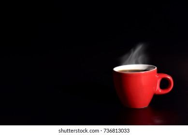 Red cup coffee on balck background for love concept, relax concept, drinking concept for advertisement, selective focus on cup edge