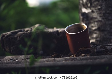 The red cup on the slate in the morning with dark dramatic filter.Poor, homeless concept