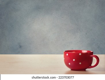 Red cup on the table