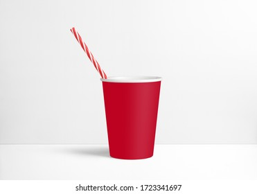 red cup with a straw on a white background