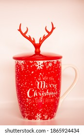 red cup of tea with christmas decoration isolated on white background.photo taken by Cristi Dangeorge in the studio on December 2, 2020 in Bucharest - Shutterstock ID 1865924434